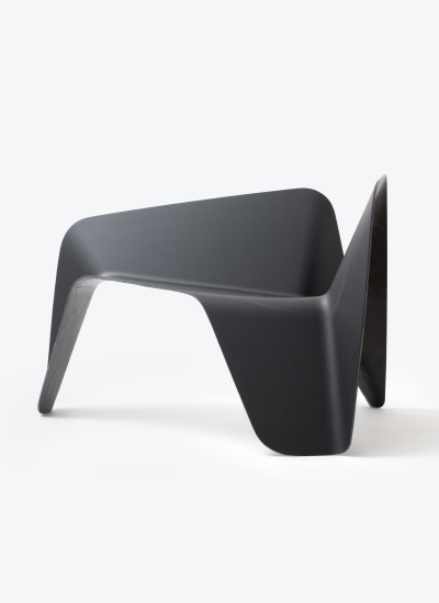 Thomas Freichtner's 'Carbon' lounge chair from 2015 was shown at the  Austrian Design Pioneers  show at Milan Design Week. Made from sheets of pre-woven carbon fibre.
