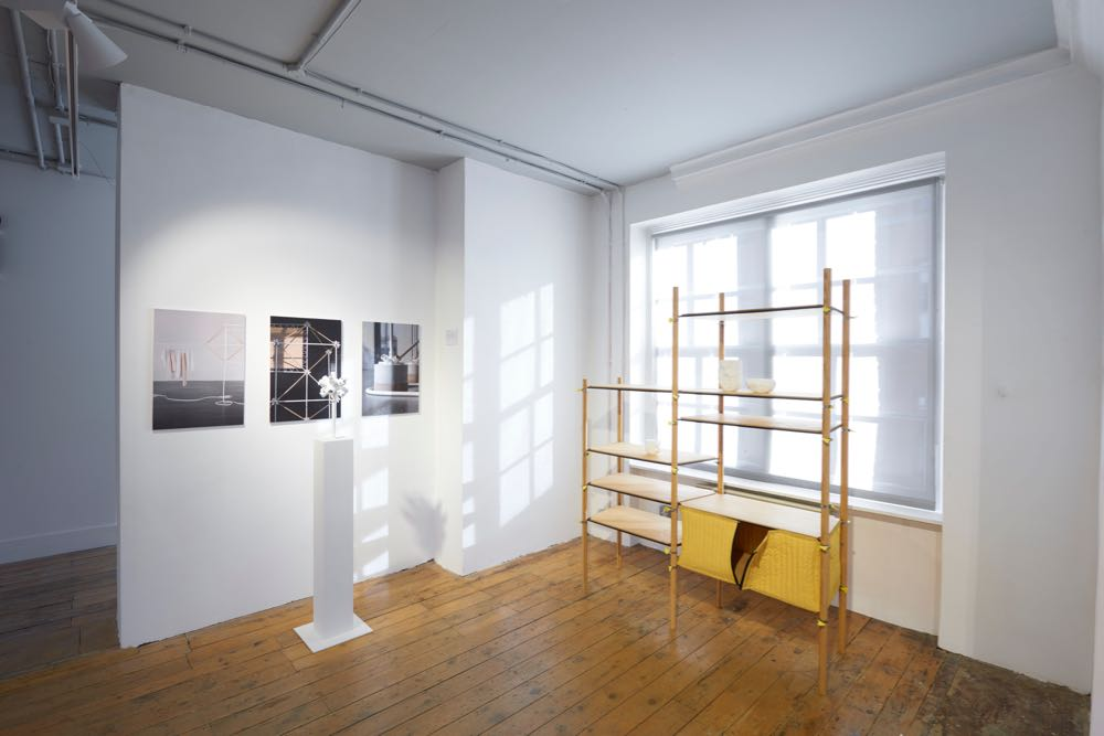 A corner of the exhibition showing Max Frommeld's 'Hose Clip' shelving and Bonsoir Paris'  shelving component for Cos. Photograph by Sylvain Deleu.