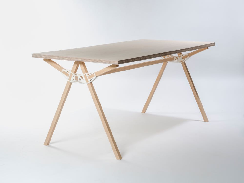 Keystone table by Studio Minale-Maeda (2014) uses a 3-D printed open joint that joins several timber sections together without the use of screws or glue. The table received the Grand Prize Interieur Award Kortijk, Belgium in 2014.