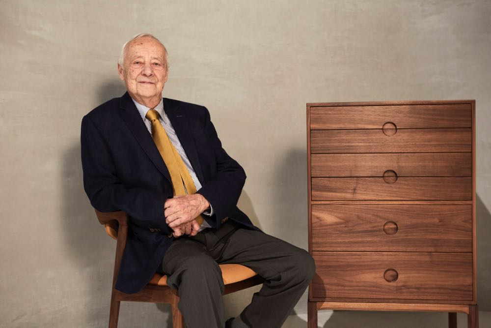 Kai Kristiansen seated in his famous Model 42 dining chair (now reissued by Miyazaki) and the newly reissued Entré 3B chest of drawers produced in Denmark for Great Dane Furniture.