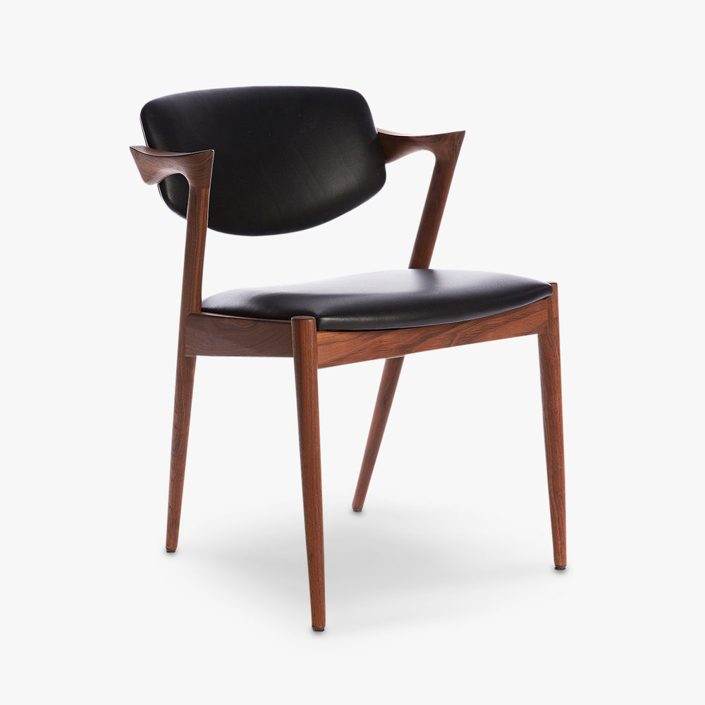 The Model 42 chair by Kai Kristiansen has become an icon of Danish design and has been reissued by high-end Japanese manufacturer Miyazaki. While a highly compact design it is known for being extremely comfortable.