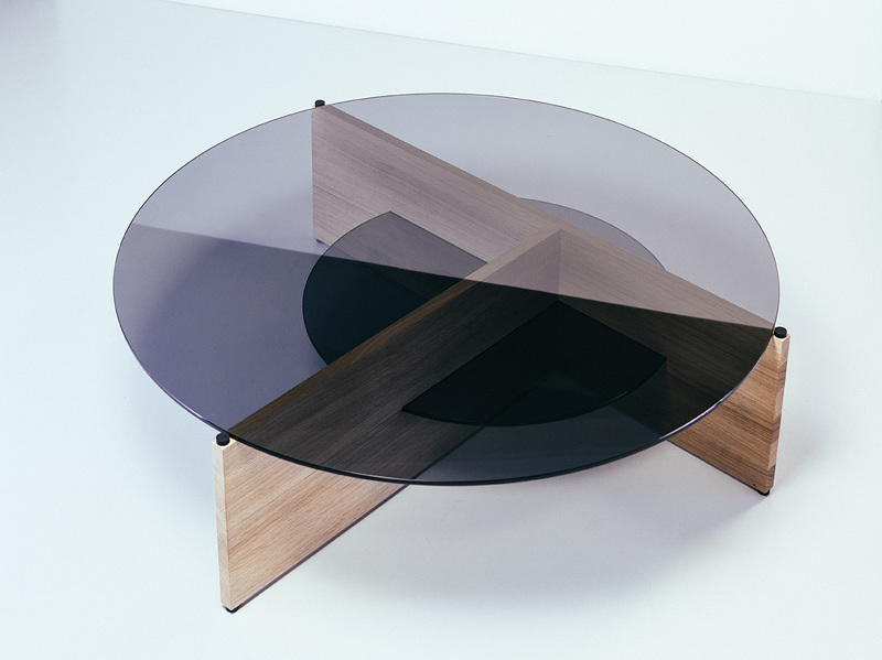 Ulvio's 'Divide' table is a flatpack design with demountable oak base that incorporates two discs of smoked glass. Circles and crosses are a strong feature in Ulvio's work.
