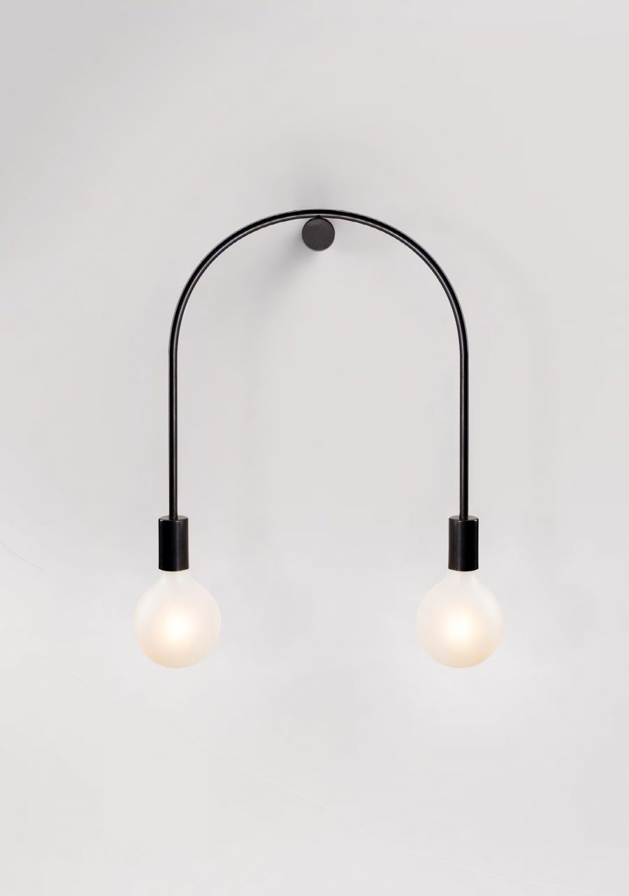 Volker Haug's 'Only U' wall fixture - two bulbs pivoting on a single point - like a tight rope walker with his balancing bar.