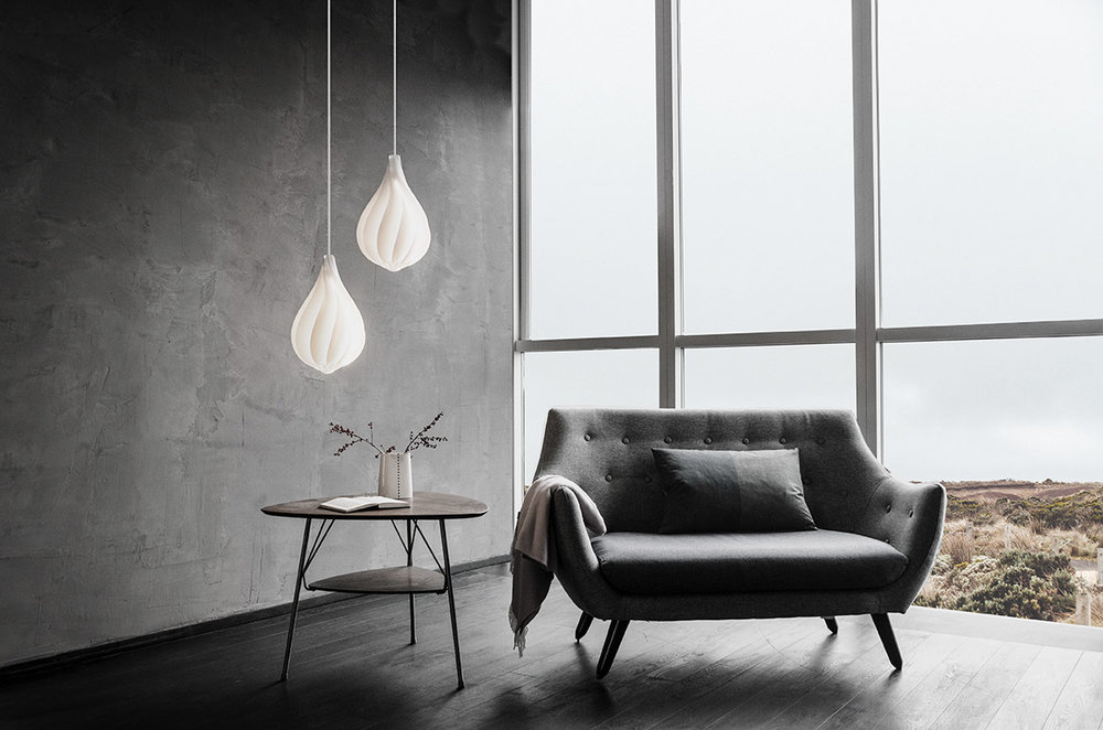 "An evocative image from the catalogue of Danish lighting company Vita Copenhagen. Their ""Alva' lights apply a lovely twist to the classic edison bulb shape. (Poet sofa by Finn Juhl)"
