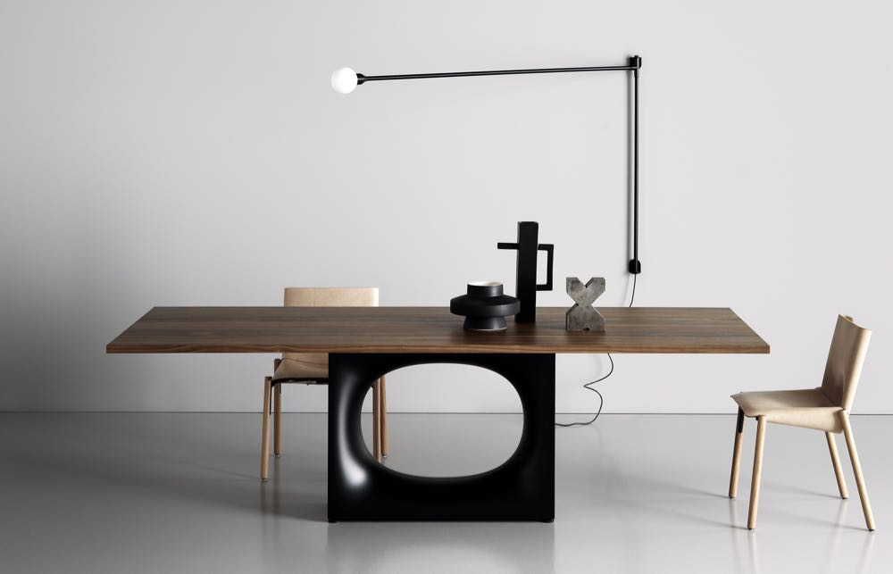 The 'Halo' table by Kensaku Oshiro for Kristalia. It's amazing the difference a wood top makes.