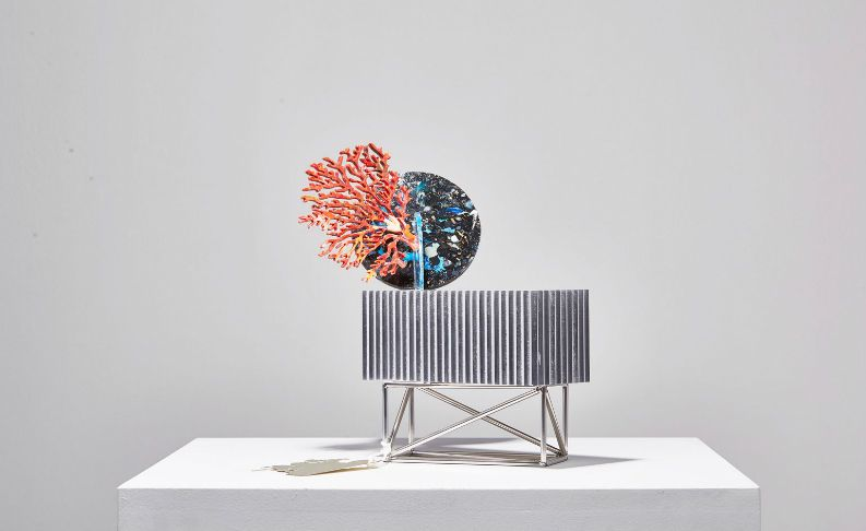 Studio Swine's featured item selected by Nigel Coates is a sideboard exploding with a disc of sea-plastic adorned with coral.