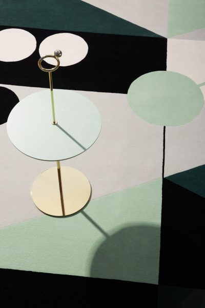 Maison Dada's 'Shanghai by Night No 1' rug with their 'Off the Moon' side table No 2'.