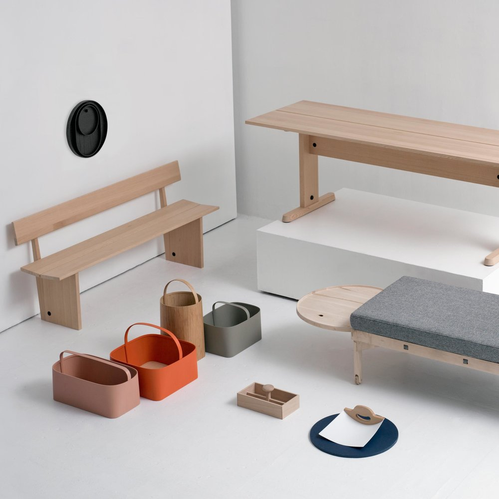 A scene from the Furnishing Utopia exhibition with bench and baskets by Studio Gorm, daybed by Darin Montgomery, toolbox by Hallgeir Holmstvedt and wall trays by Norm Architects.