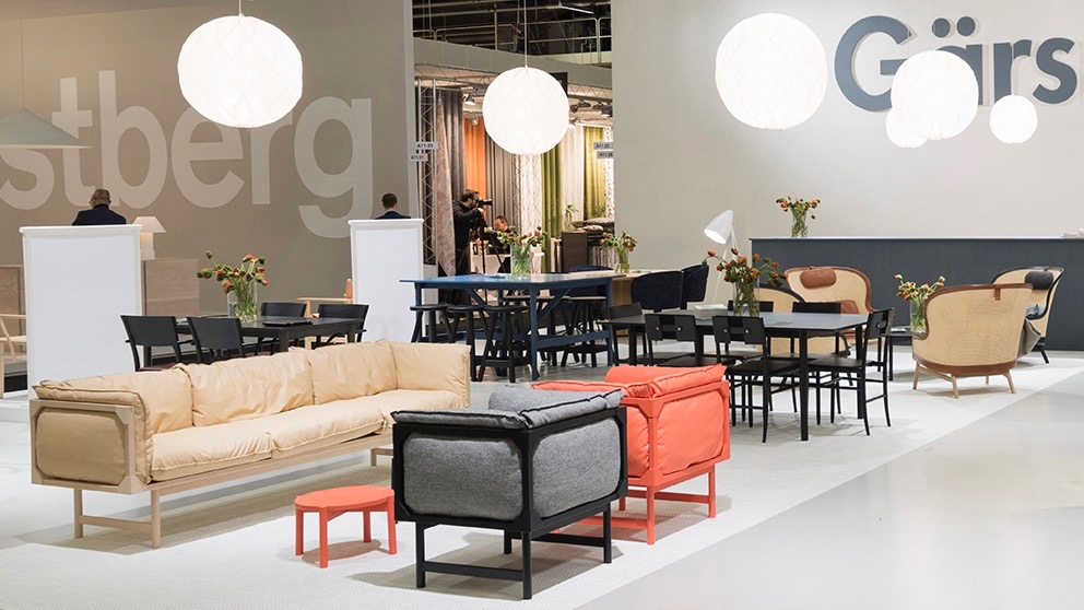 The Gärsnäs stand at Stockholm 2017 showing their new 'Bleck' sofa and armchairs by TAF Arkitektkontor and 'Dandy' cane armchairs (back) by Pierre Sindre.