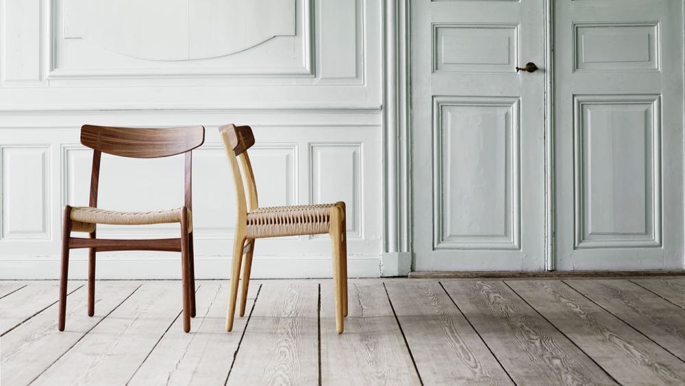 Hans Wegner's classic CH23 chair from 1949 has been reissued by Carl Hansen & Son. Previously in teak and oak it is now available in walnut and oak or in an all-walnut version.