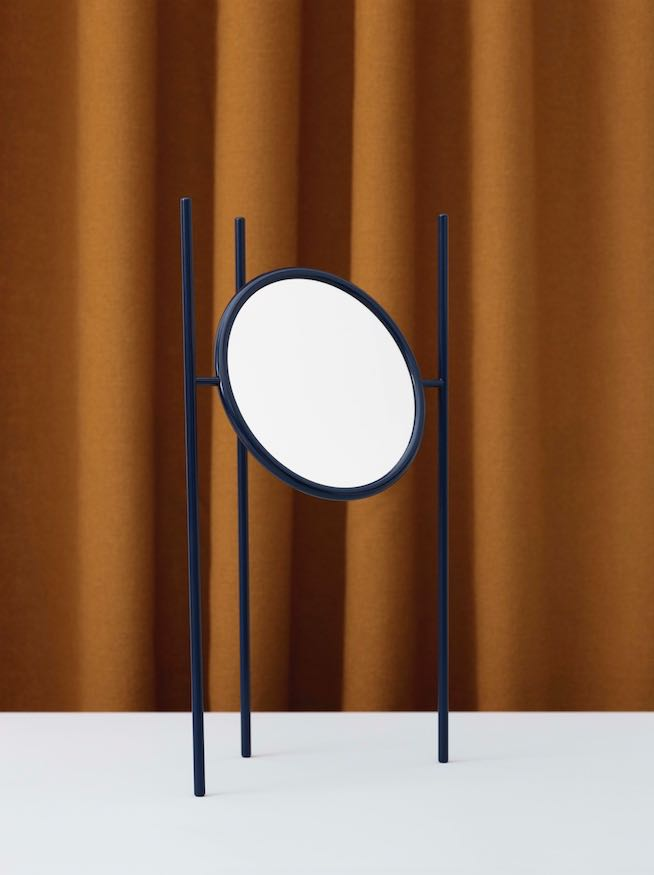 'Aase' is a table top mirror by Andreas Bergsaker. One side is standard mirror while the other has 10x magnification.