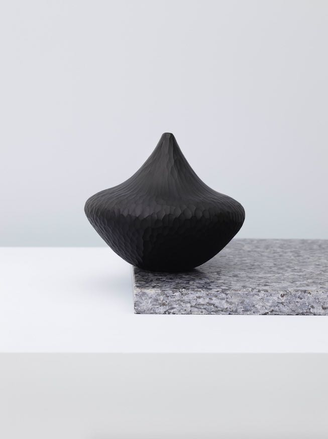 'Peak' glass vessel by Kari Mølstad. The vessels is cold worked after blowing to create a matt chiselled surface. The usual glossy quality of glass is replaced with a stone-like appearance.