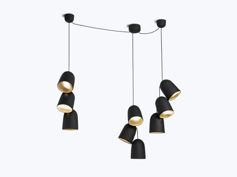 The 'Chains' pendant lights by Sylvain Willenz for Petite Friture uses ribbed PET felt for its can-like shade and can be purchased as singles or in clusters as shown.