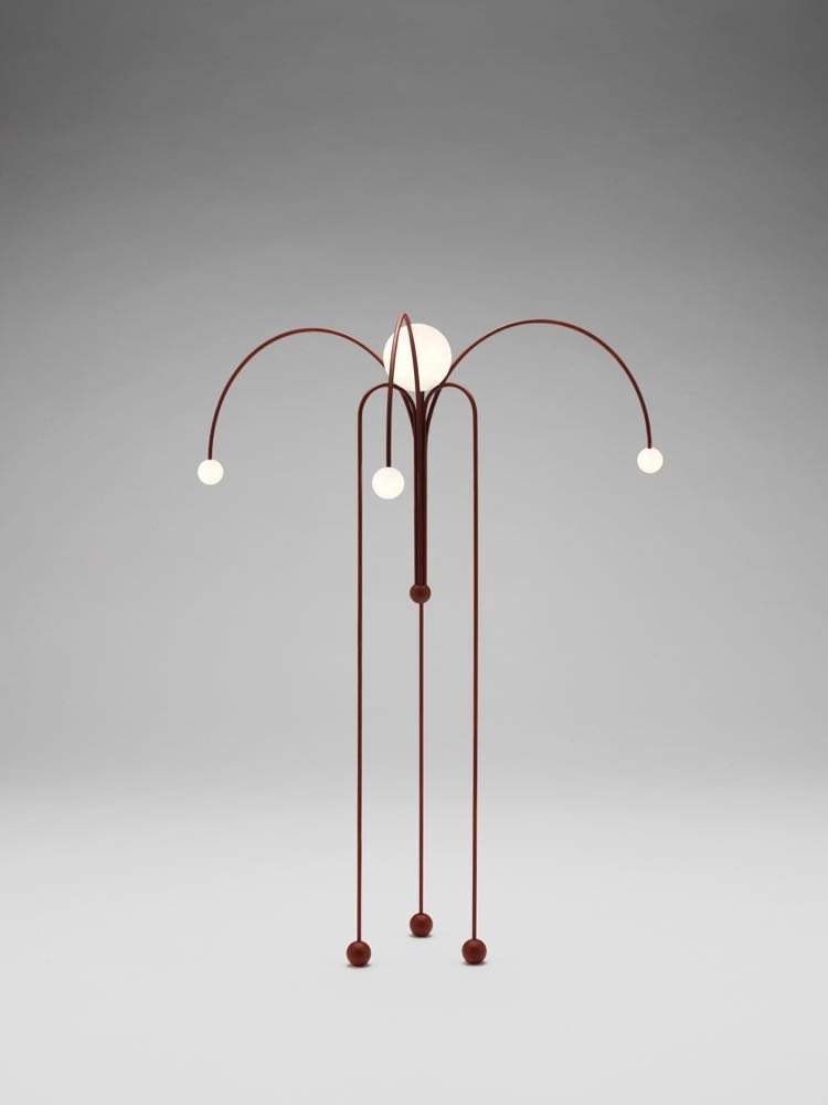 'Fontana Amorosa' by Michael Anastassiades for NIlufar Gallery. Jus tone version of a while collection of 'weeping' lights in Bauhaus red by Anastassiades. The designer also presented new work for Flos and for his eponymous brand at Euroluce.