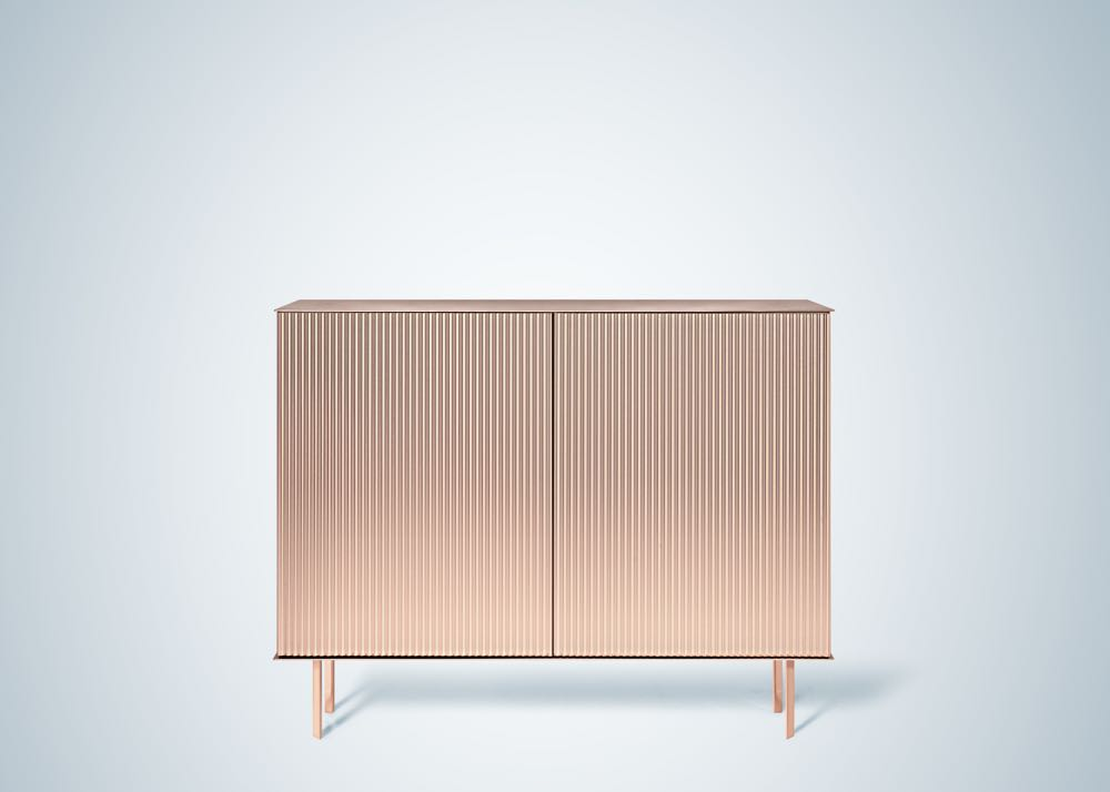 The 'Elizabeth' cabinet in corrugated copper by Nathalie Dewez for De Castelli - part of the Tracing Identity exhibition. Fine triangular folds create a sense of rhythm & precision. Available in copper, brass or stainless steel. Photo: Massimo Gardone.