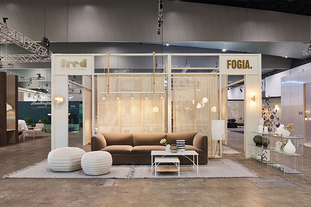 The Fred International stand featuring the 'Retreat' sofa, 'Poppy' pouf and 'Tabula' side tables (above).