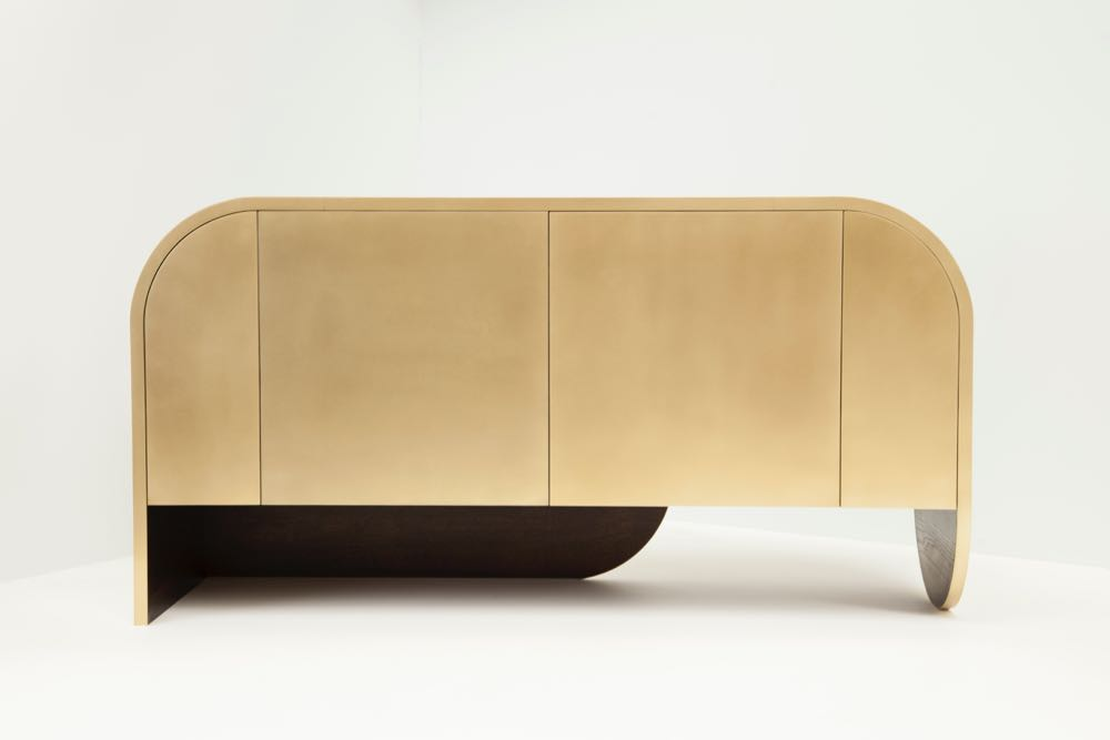 Jonathan West's 'Brass' cabinet eschews convention with unusual blade legs and a rounded top surface.