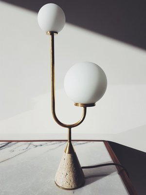 The 'Arancini Jnr' table lamp in travertine, opaline glass and brass by Michael Chazan for  Moda Piera.