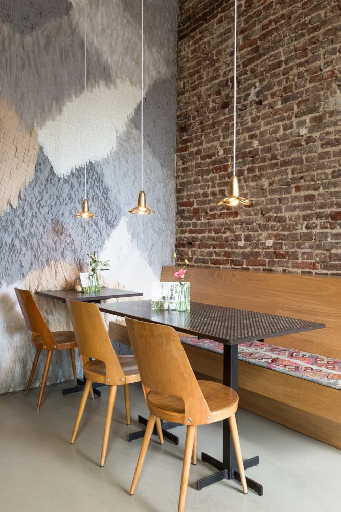 Clouds9000 cafe interior - rough brickwork walls and oak banquettes and chairs.