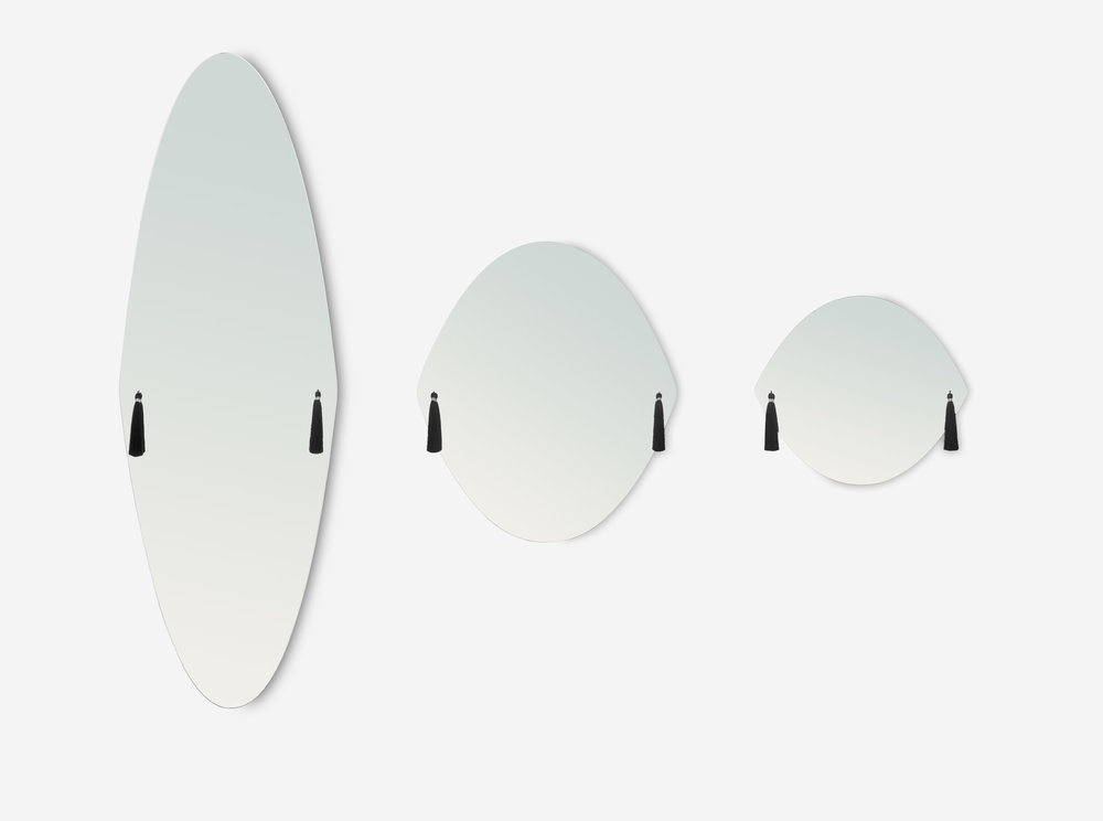 The 'Panache' mirrors by Constance Guisset for French label Petite Friture. The mirrors are available in the three shapes shown and feature tassels in a choice of colours.