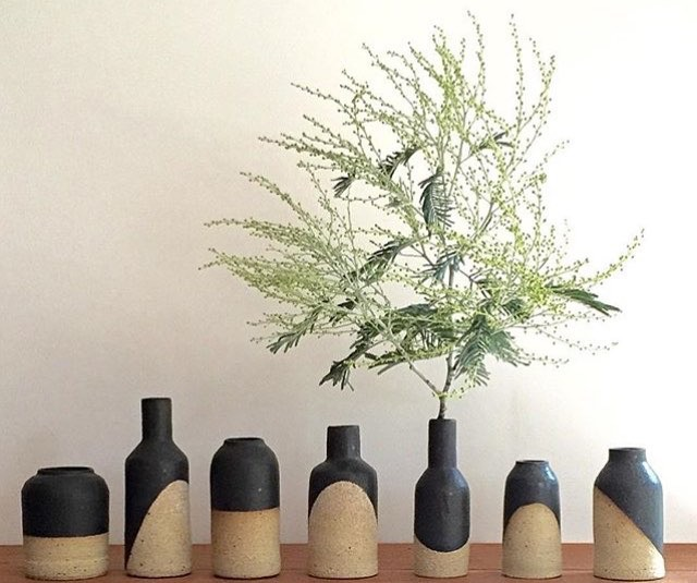 Penelope Duke stoneware vessels with charcoal glaze. The groups decoration creates a dynamic geometric tableau.