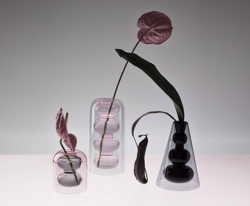 A selection of Tom Dixon's 'Bump' vases showing their internal shapes enveloped in a smooth coating of transparent glass.