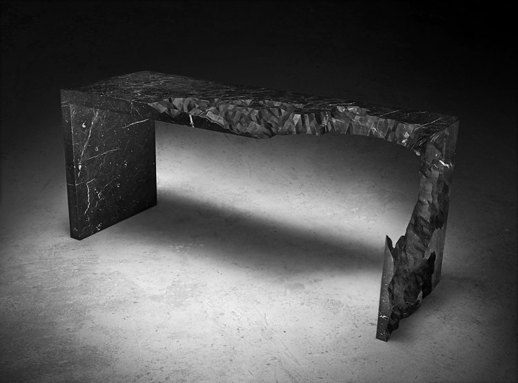 'Information Ate My Table' by Zac Eastwood-Bloom is made from solid black marble carved by cnc and finished by hand by stone specialist Torart in Carrara. Photograph, Jonathan Minster. The design reworks a similar piece created in timber in 2010.