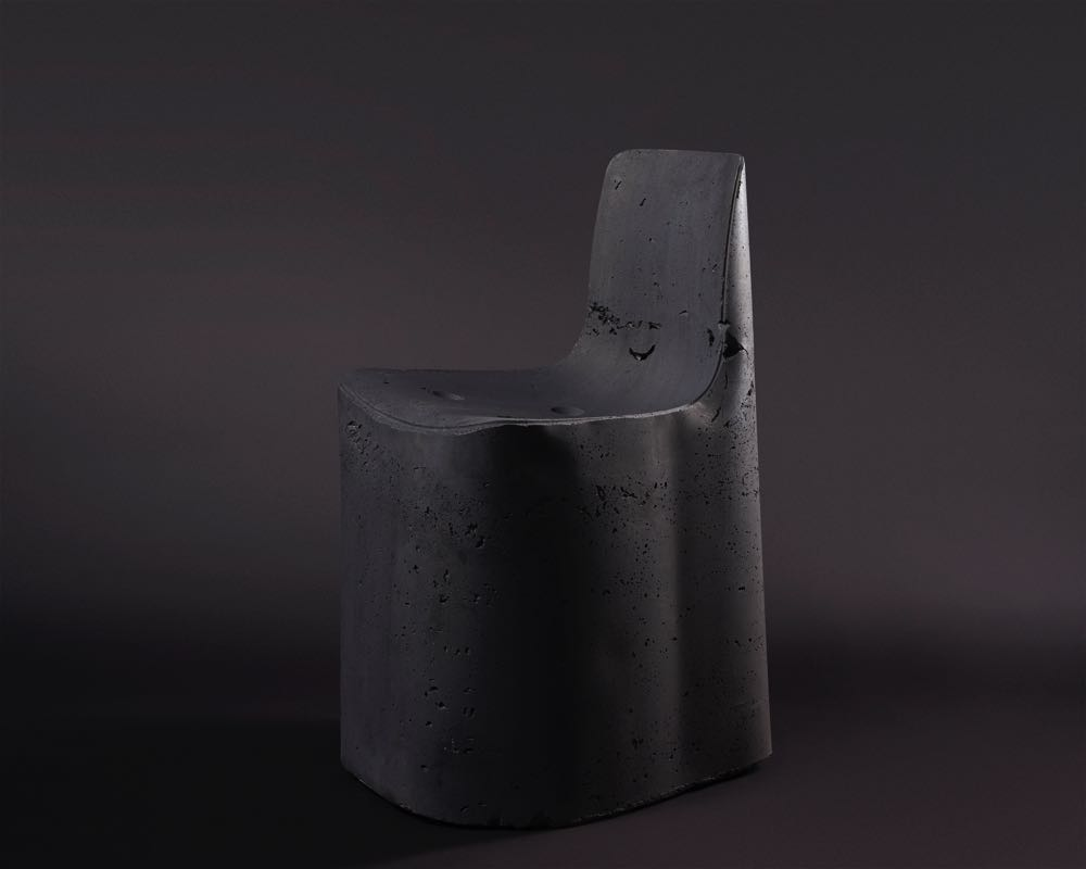 Tom Fereday's concrete mono block chair for the Original Fakes exhibiton. There is a replica 'Hal' chair in their somewhere!