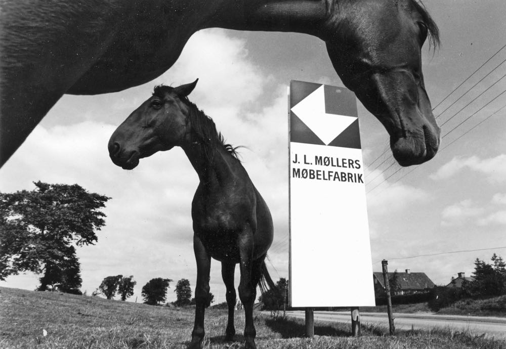 An artful archive image of the JL Møller factory sign.
