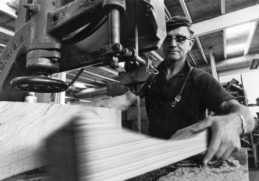 Archive image of bandsaw cutting of chair parts. This traditional method is still continued to this day to ensure the wood grain and colour is appropriate for each specific part of a chair or table.