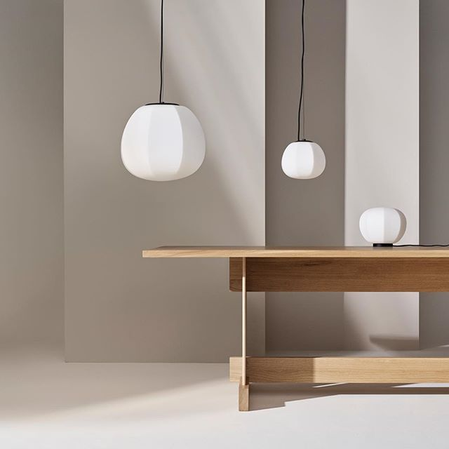 New from Swedish company Fogia is the 'Grand Table' and 'Persimon' pendant lights by Note Design. The whimsy of the lights are beautifully balanced against the angular structural qualities of the table. The 'Persimon' lights look like fabric from a distance but are actually made from opaline glass.