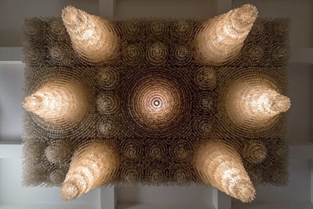 Panton Stube - the view from below revealing the huge number of mother of pearl shells that make up the light fitting and its absorbing decorative appeal. Photograph by Rolf Frei.