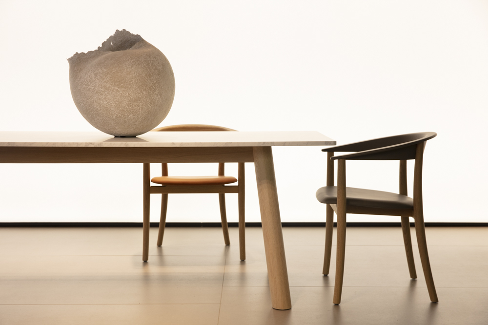 Naoto Fukasawa's new 'Bull' table and 'Belle' chair designs for B&B Italia. The delicacy of the chair is in stark contrast to the chunky solid timber table.