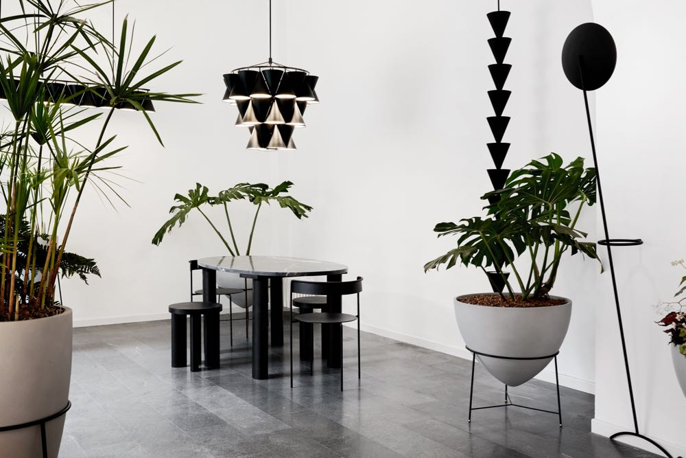 The  Matter Made  installation with their new Sergio Rodrigues designed cement planters and in the background Luca Nichetto's fabulous new lighting system 'Legato'. Photo by Brooke Holm.