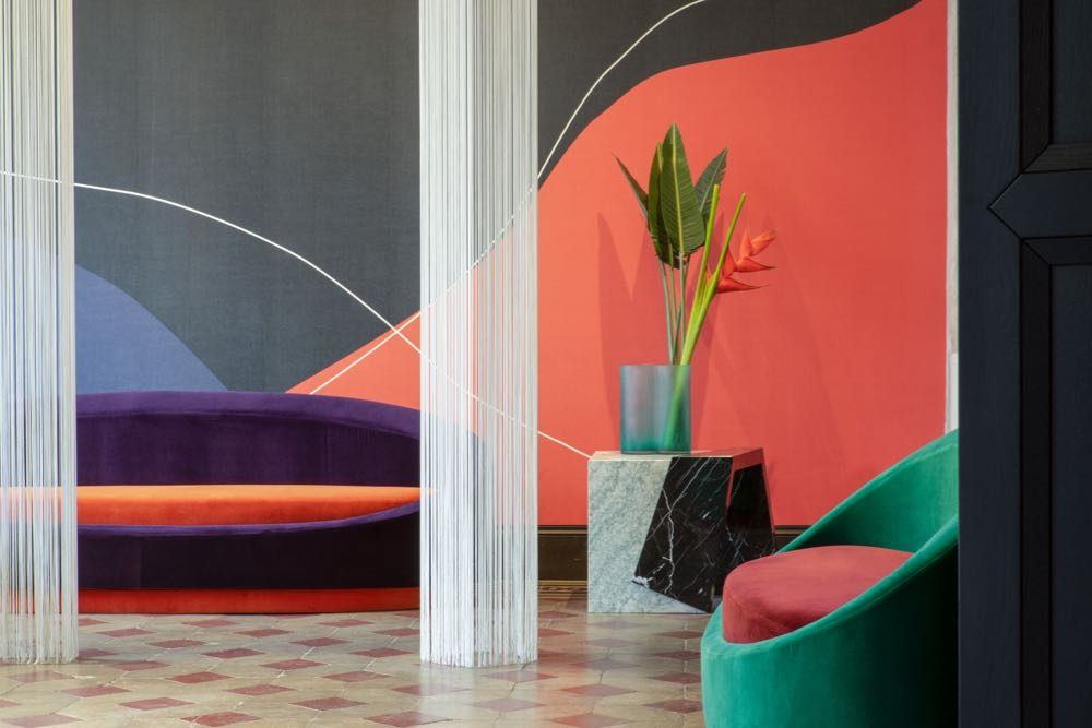 Paradiso Terrestre x Texture installation with the 'All Around' sofa and 'Other Side' coffee table by Pierre Gonalons.  Texturae wallpaper  on the wall. Photograph courtesy of Paradiso Terrestre and Texturae.