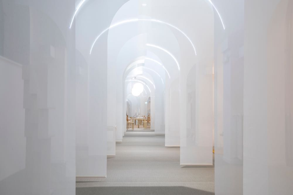 The Swedish Design Moves -  HEMMA Stories of Home  installation. The layered arches in soft white created a semi-religous experience. Photograph by Mattia Buffoli.