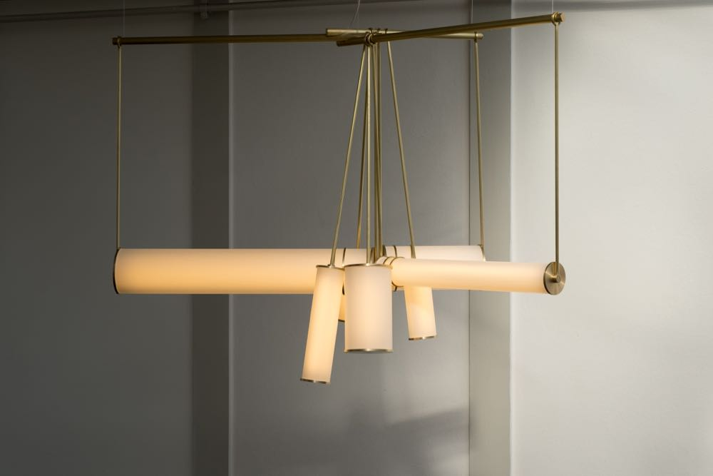 Studio Truly Truly's  'Pitch' light is made from machined brass and sandblasted glass. The prototype can be hung in various configurations to provide horizontal or vertical emphasis.