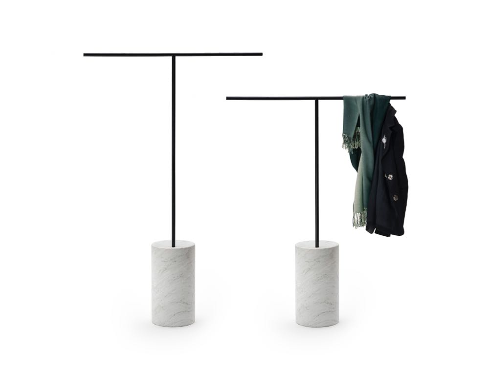 Living Divani's ultra-minimalist clothes rail 'Tombo' by  Junpei & Iori Tamaki  looks beautiful as an objet d'art or when draping just one item. The design also works for a larger amount of clothes with simple closed circle hooks that thread onto the T-bar.