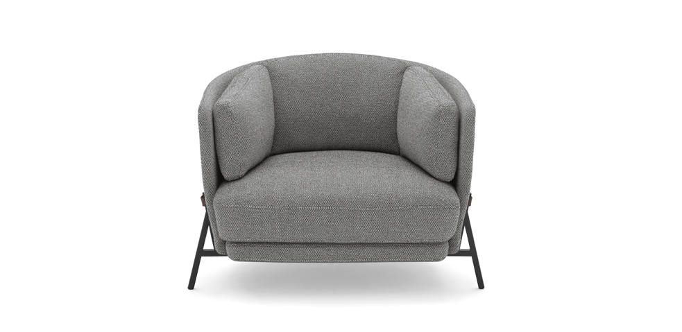 The 'Cradle' armchair by  Neri & Hu  for  Arflex . The chair features a strap that runs around the back of  the chair between the legs. A version with integrated side table that continues off one of the legs is also available.