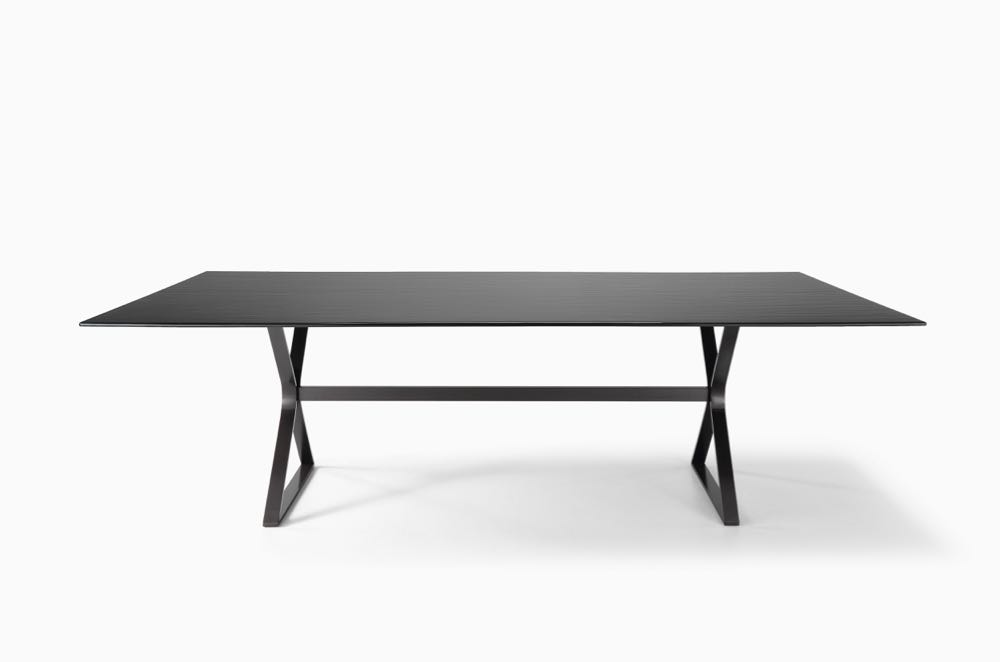 The 'Hype' table by  Studio Klass  for  FIAM Italia . Executed in fused and tempered glass and steel, the table's elegant geometry is set off by the unique qualities of it's slab glass top.