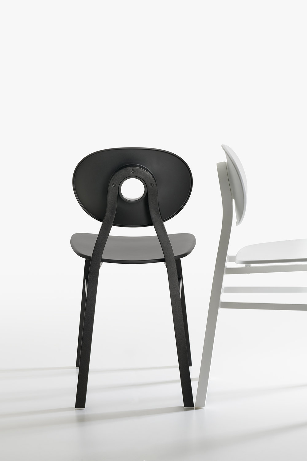 The 'Elipse' chair by Patrick Jouin for Zanotta. Aluminium frame with polypropylene seat. Photograph by Miro Zagnoli.