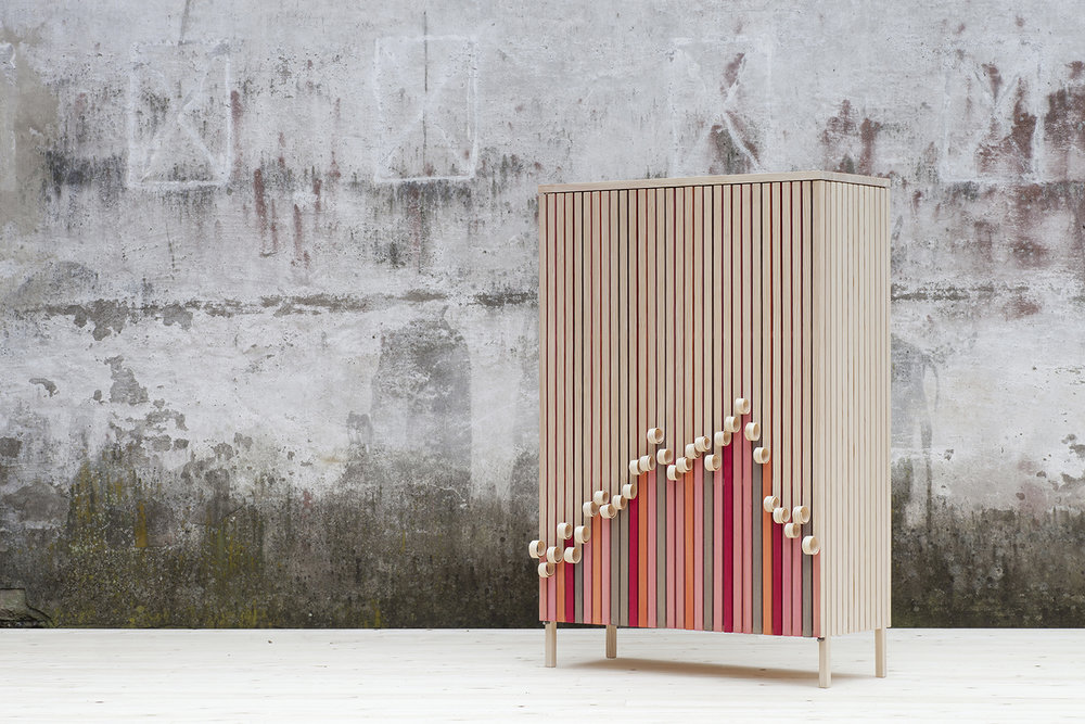 Stoft Studio's 'Whittle Away' cabinet is an eye-catching design with it's clever use of coiled wood veneer strips and alternating coloured battens.