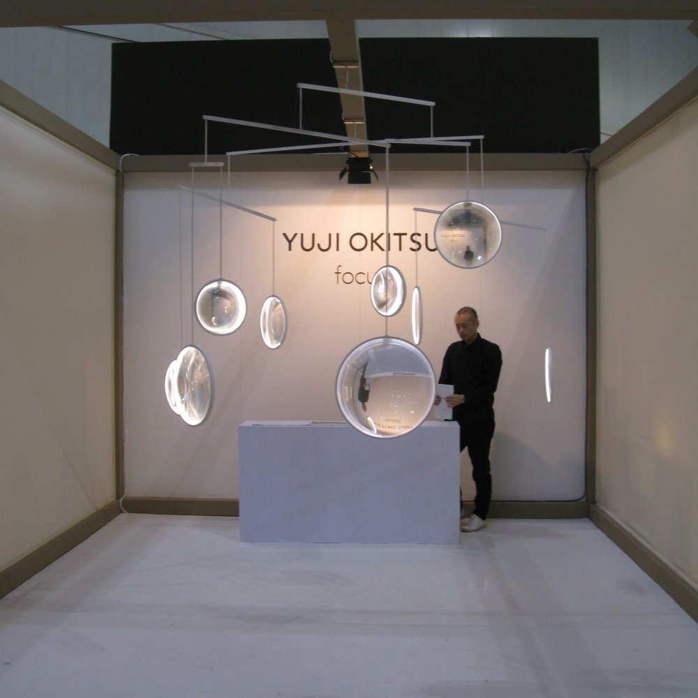 Yuji Okitsu's  'Focus' - a cross between a mobile and a light. There is no visible light source with a special lens appearing to capture light from the room itself.
