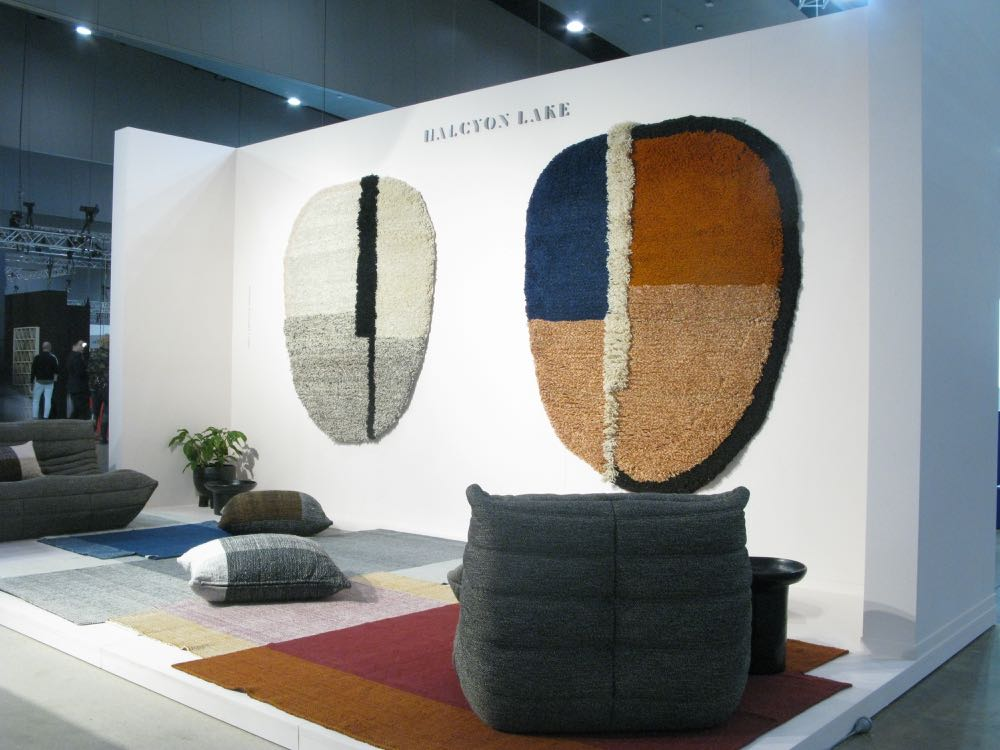 The Halcyon Lake stand featuring Columbian rug brand Ames with rugs by Sebastian Herkner. Shown on the wall are his 'Nudo' rugs on the floor are his 'Nobsa' rugs.