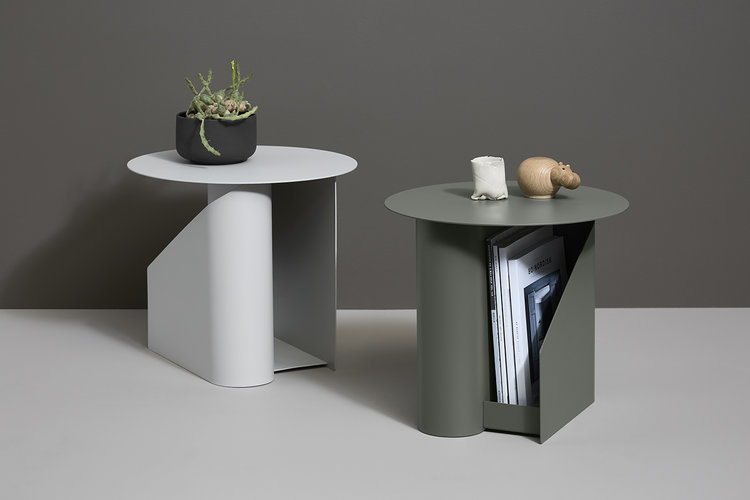 The 'Sentrum' side tables by Maximilian Schmahl and Fabian Schnippering for Danish brand Woud provides magazine / book storage on both sides of an S-shaped base. Available in warm grey and dusty green.