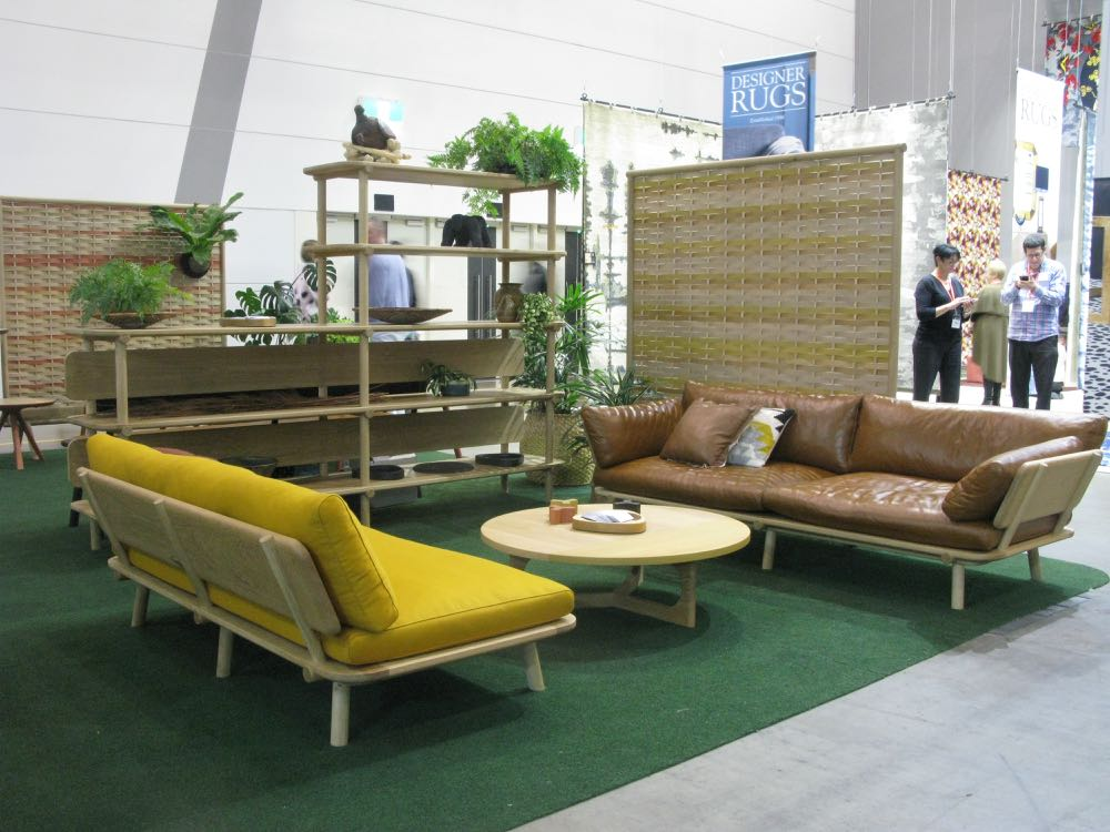 Brad Nicholls Design stand at DENFAIR featuring the characterful 'Town & Country' sofa in oak and new woven timber screens.