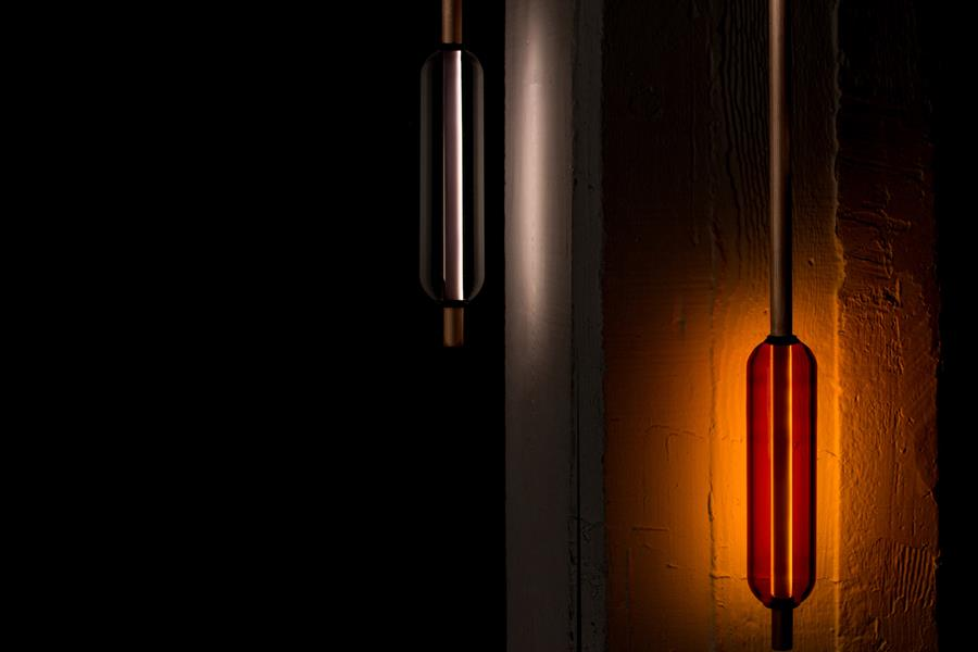 Copper Design's new 'Flask' light - handblown glass and metal rods with internal dimmable LED. Multiple flasks can be positioned on the fitting and specified in a number of colours.