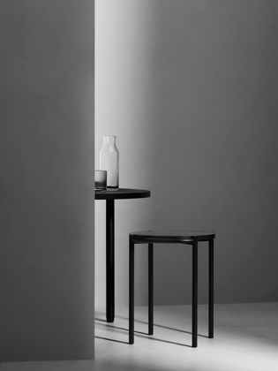 Fomu Design's single side table in powder coated steel and black stained oak.