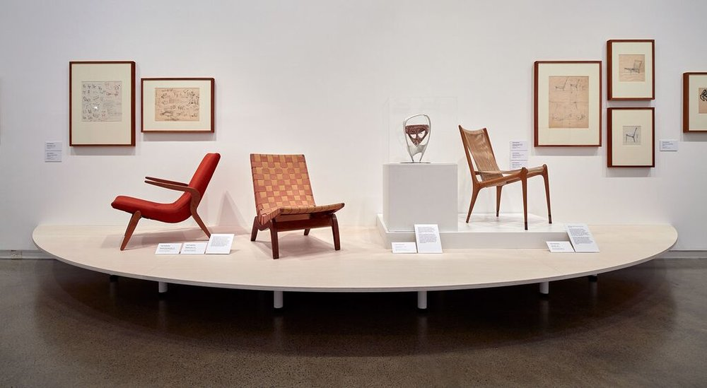 The Relaxation chair in its fully upholstered form (left), the Relaxation chair with interlaced woven webbing (centre) both from 1947 and the Cord chair from 1950 (right). The Head sculpture in plaster and steel is by Grant Featherston from 1950.
