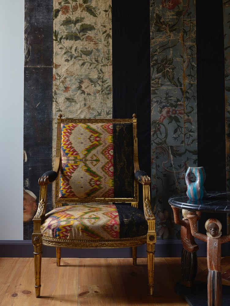 The home of Henk Duijn and Hubert van der Meer in south east France. The chair was upholstered to aline withe the fabric covered walls behind.
